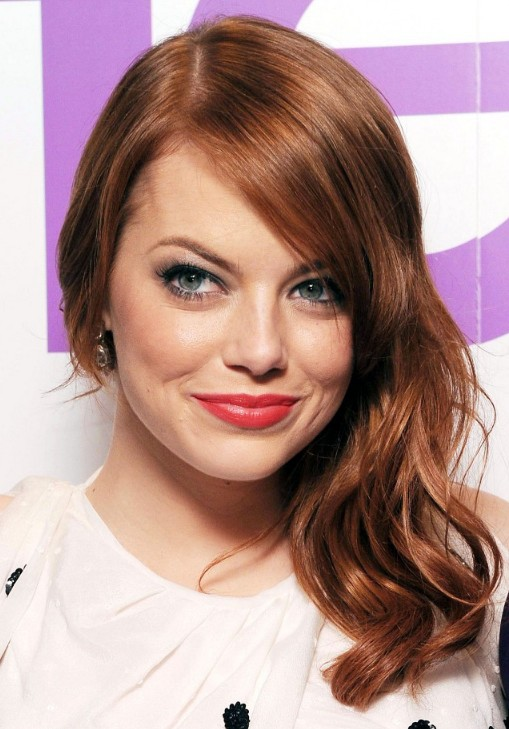 Reddish Blonde Hairstyle with Side Part