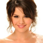Selena Gomez Cute Hairstyle with Side Bangs
