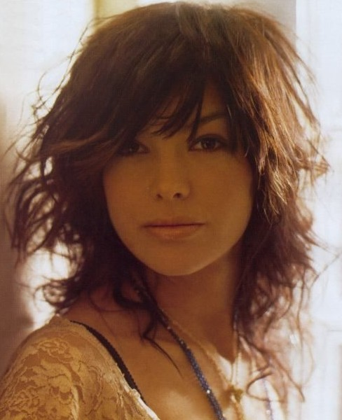 Layered Medium Messy Curly Haircut with Side Bangs