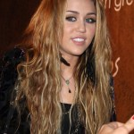 Popular Hairstyles for Girls: Miley Cyrus Long Tousled Curly Hairstyle