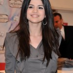 Selena Gomez Center Parted Long Straight Hairstyles