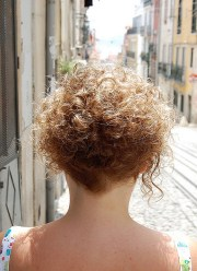 short & curly hairstyle women