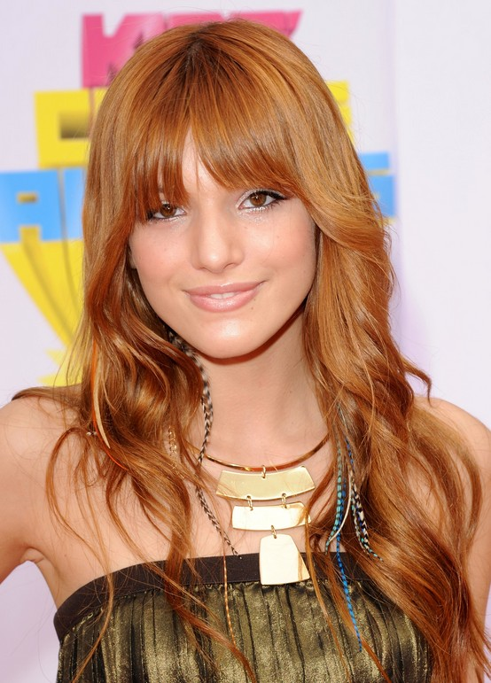Cute long copper hairstyle with bangs Bella Thorne hairstyle