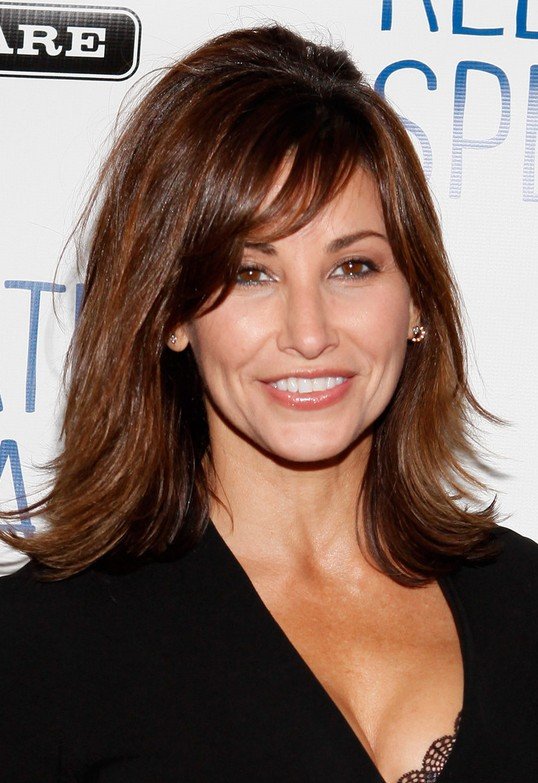 Gina Gershon 1960s Curled Out Bob Hairstyle with Side Swept Bangs