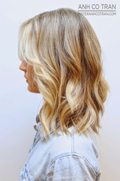 Side View of latest most popular medium wavy hairstyle 2018