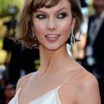 Karlie Kloss flattering short haircut with side swept bangs for women
