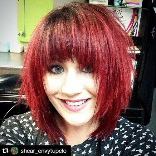 Textured short red bob haircut with bangs