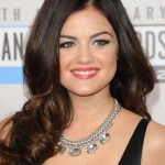 Lucy Hale long wavy curly hairstyle for round face shapes