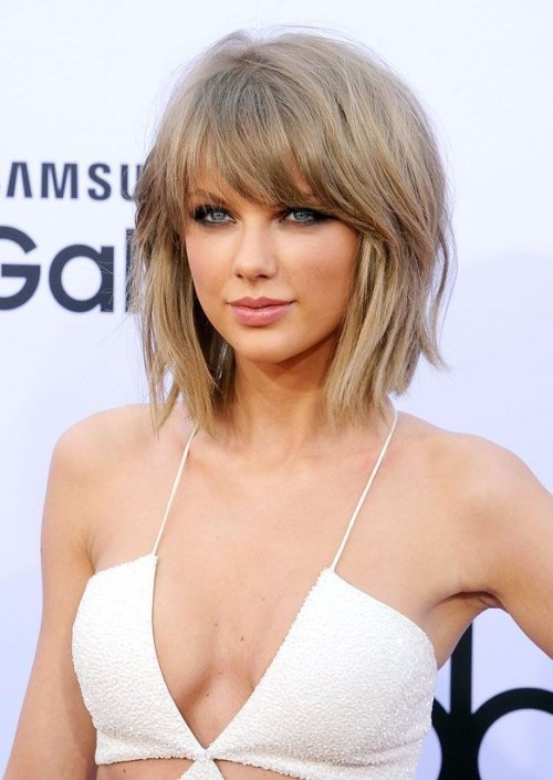 Taylor Swift short choppy bob hairstyle with bangs