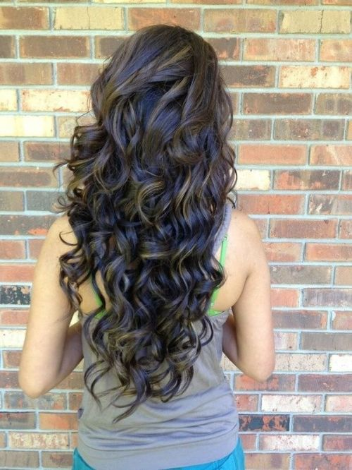 back view of layered permed hairstyle for long hair