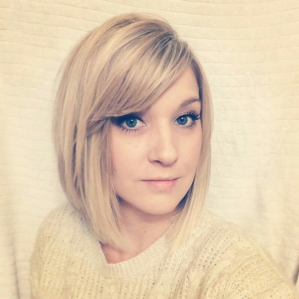 short bob haircut with side swept bangs for oval face shapes