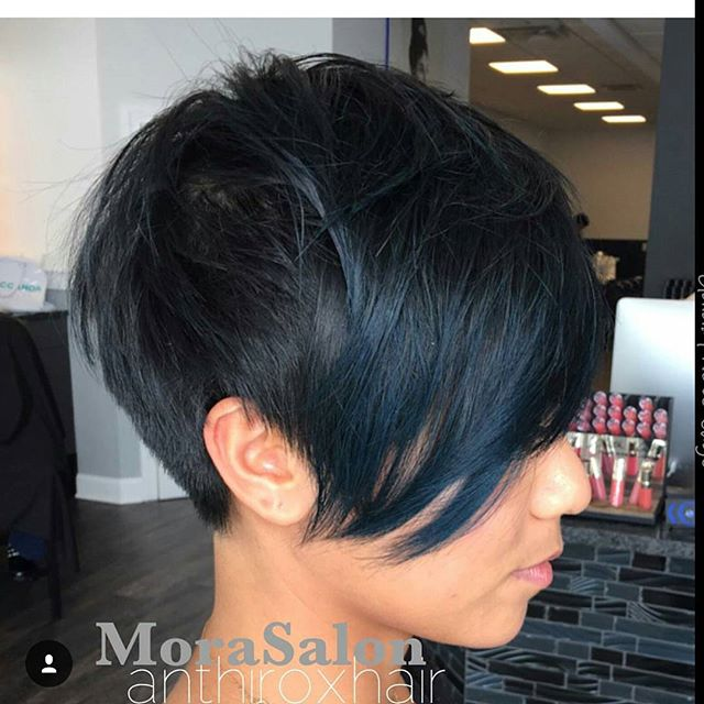side view of short black pixie cut
