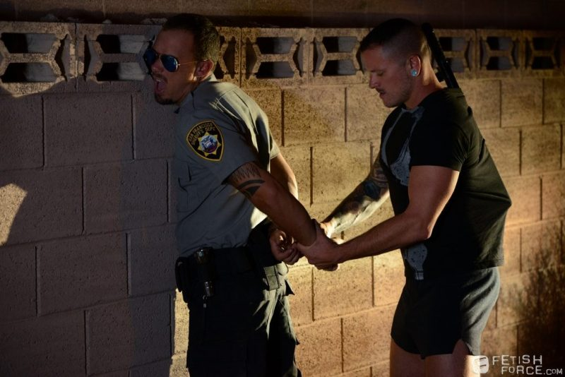 locking officer Kirk Cummings up with handcuffs 01