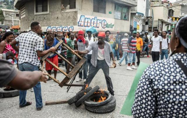 Demonstrations in the streets of Port au Prince in March 2019 demanding the removal of Haitian President Jovenel Moise AFP Photo Valerie Baeriswyl