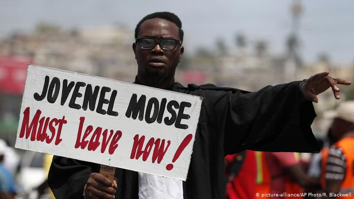 moise must leave sign credit DW