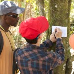 Jonathan Salazar explains how a clinometer uses trigonometry to measure the height of a tree from the ground at a set distance away from the tree.