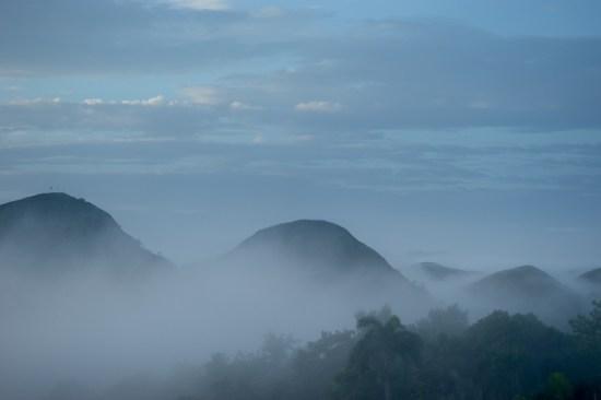 Dawn, fog. Looking South West from Zanmi Lasante, Cange, Haiti.