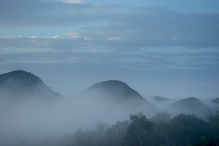 Dawn, fog. Looking South West from Zanmi Lasante, Cange, Haiti.