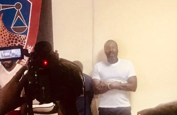 Arnel Bélizaire présenté par la DCPJ avec ses 9 armes à feu 951 munitions