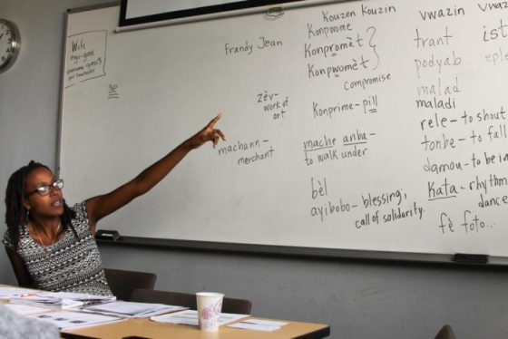 Professor Wynnie  Lamour is explaining a word she has written. Photo credit: Maya Earls