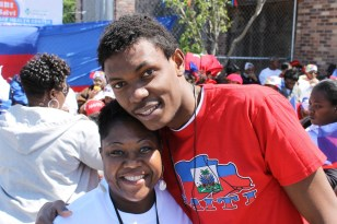 Stivenson Saint Louis, 21, of Mattapan, poses with members of the Saint Belvi Haitian Adult Day Health Center. Photo Credit: Gage Norris