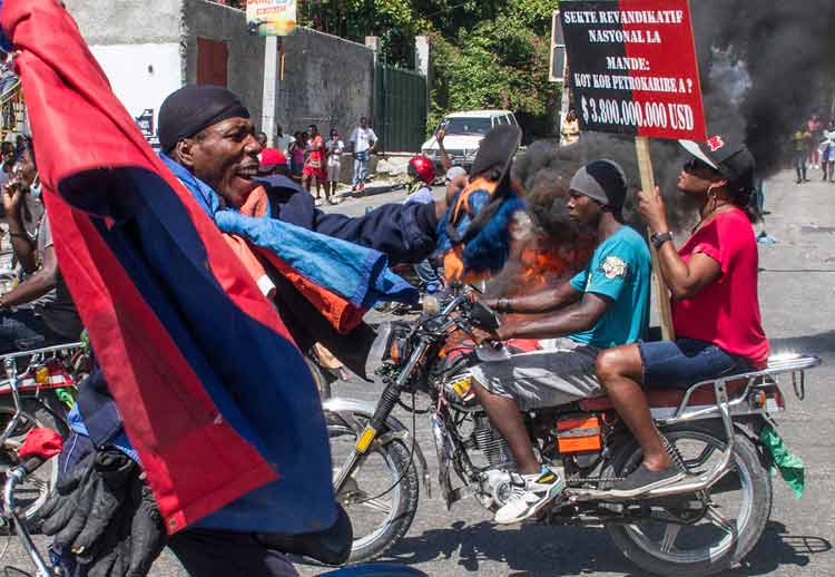 Haiti Police Open Fire on Protesters