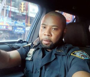 Haitian-American cop sues city, prompting calls for police accountability
