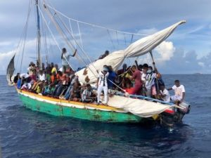 'Heartbreak' as over 100 desperate Haitians clinging to a homemade boat are intercepted off Miami