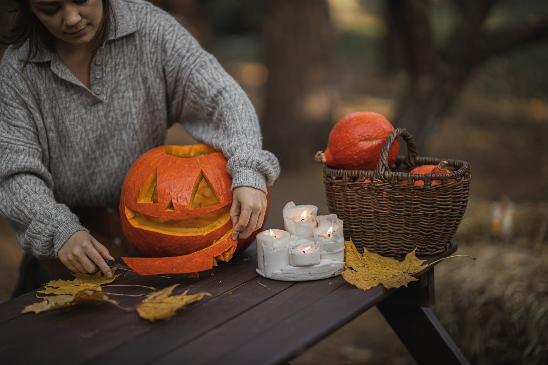 pumpkin on brown wooden table