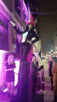 Hala on stilts tuxedo pink hat stiltwalker Toronto