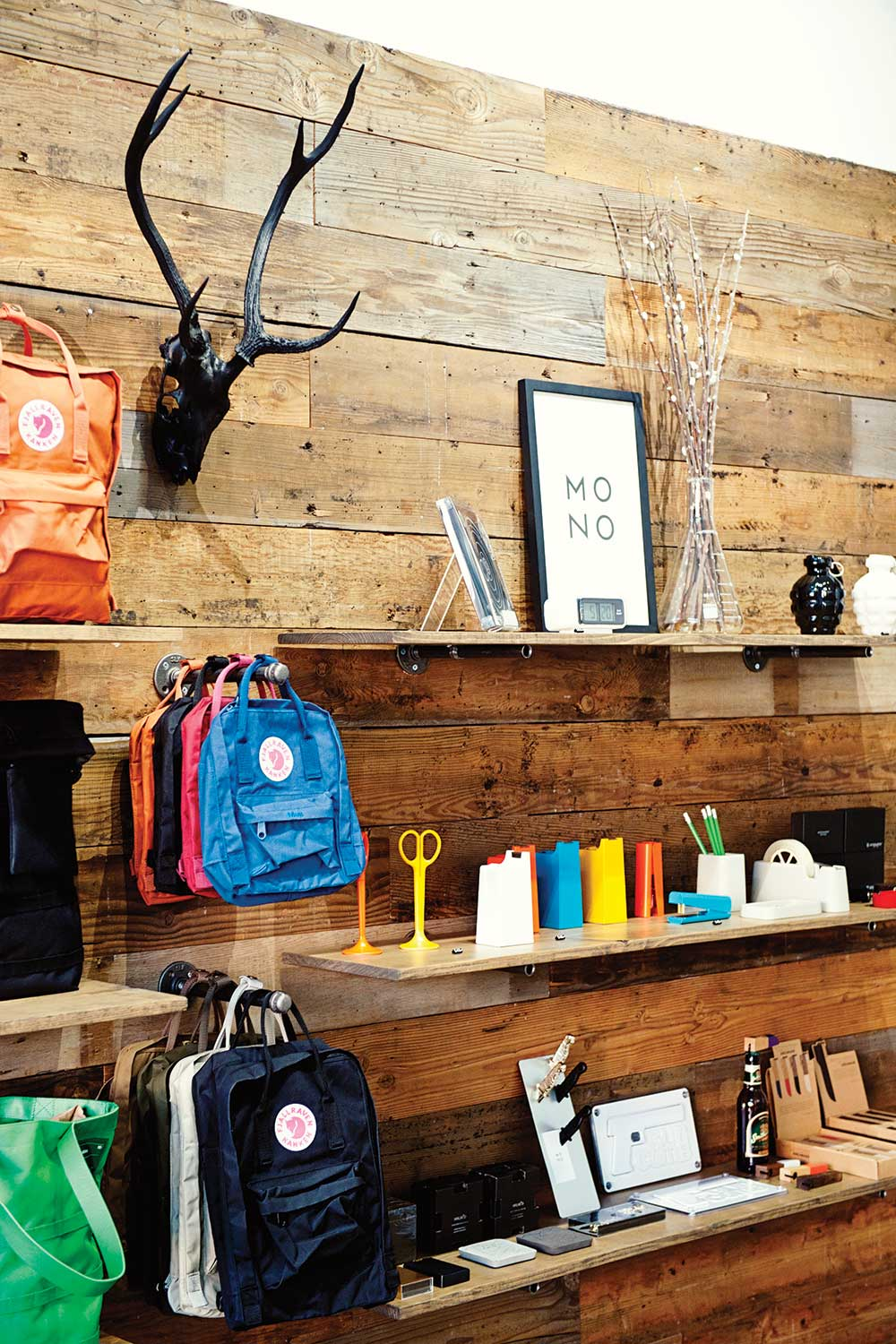 wall of Mono shop with deer antlers, backpacks and assorted accessories