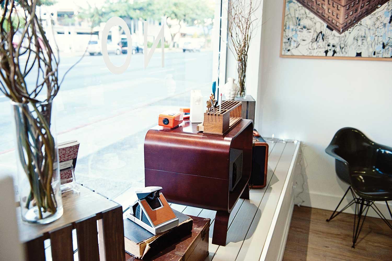 desk with accessories inside Mono store window