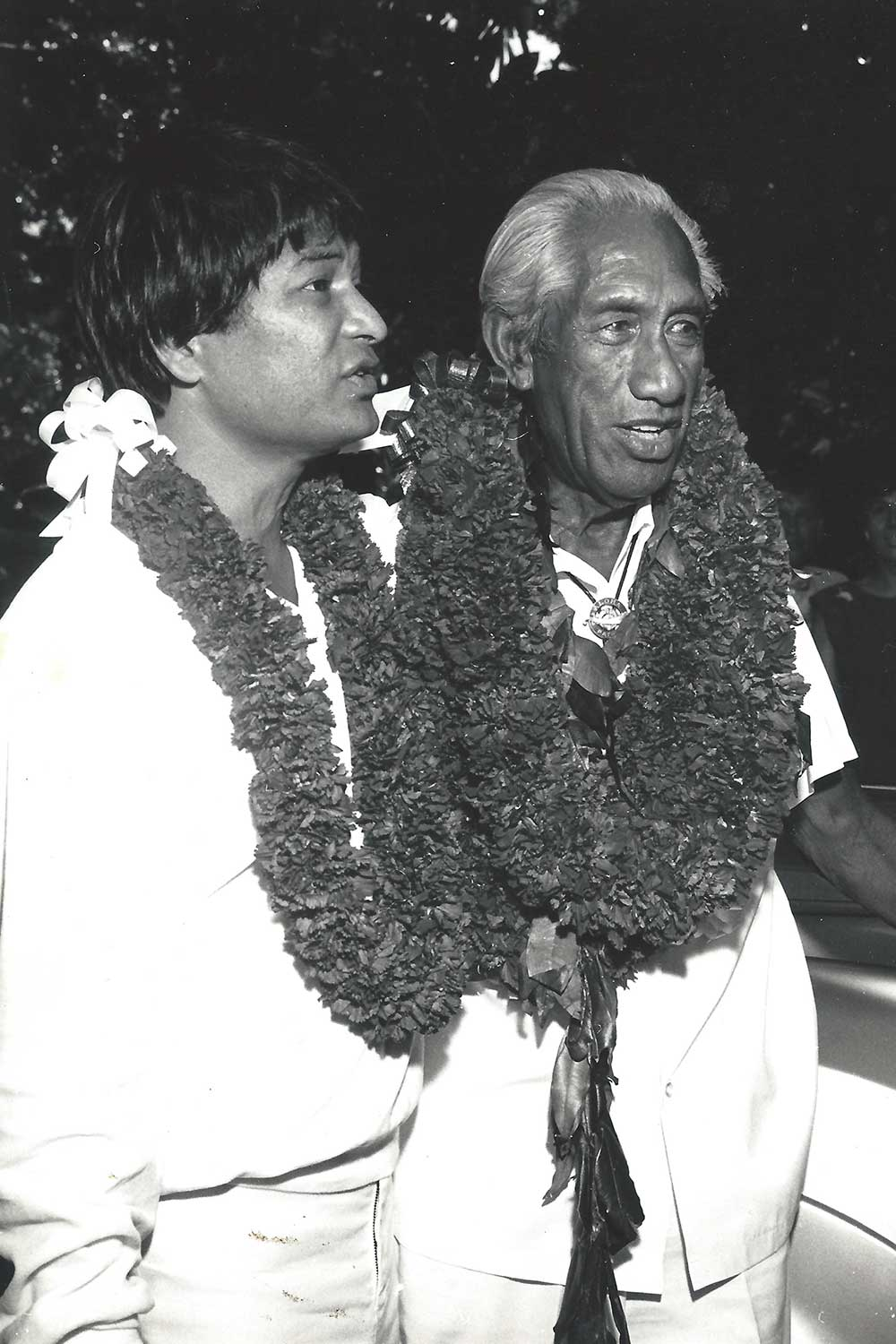 Black and white photo of Don Ho wearing a lei