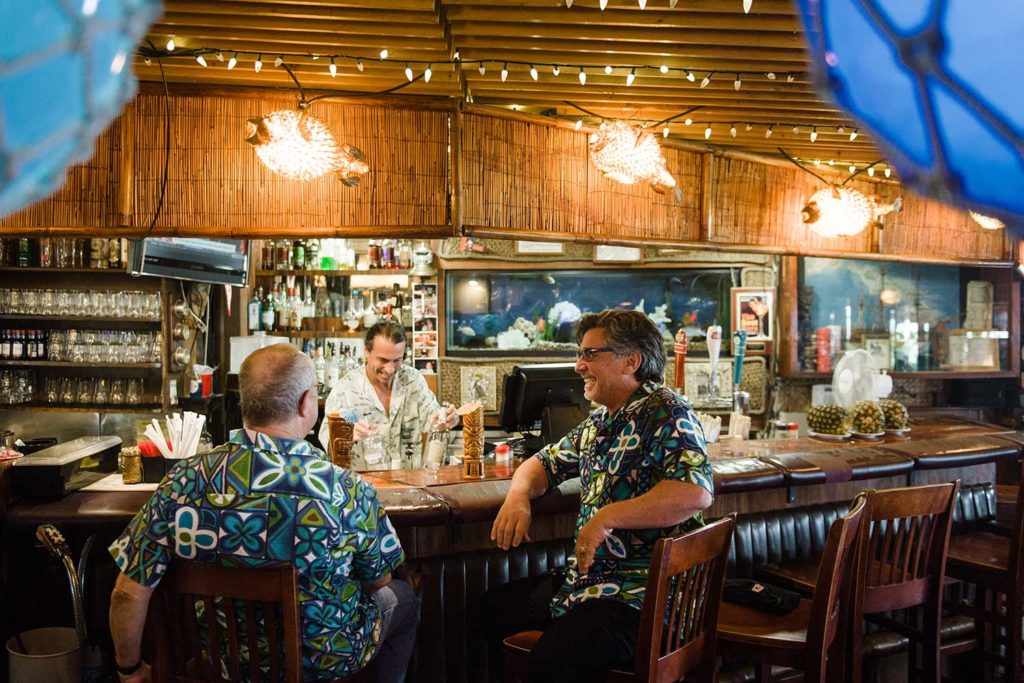 Lloyd Kandell and Kit Ebersbach sitting at a bar
