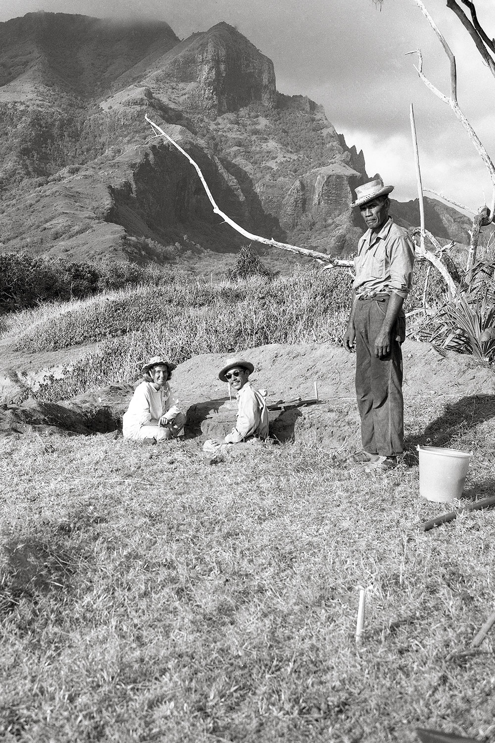 Black and white photo of three men in the valley
