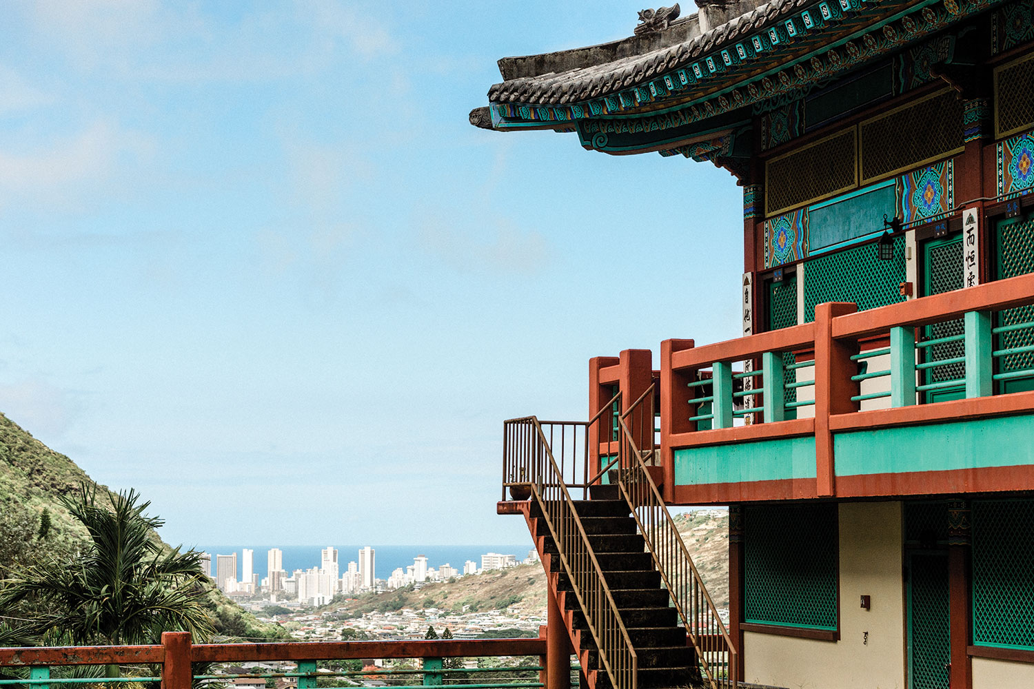 Corner of Korean Buddhist Temple in foreground with city skyline in background