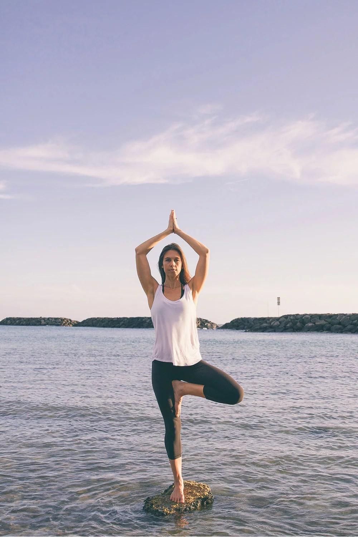 Kamala Skipper, Halekulani's lifestyle coach, balancing on the beach.