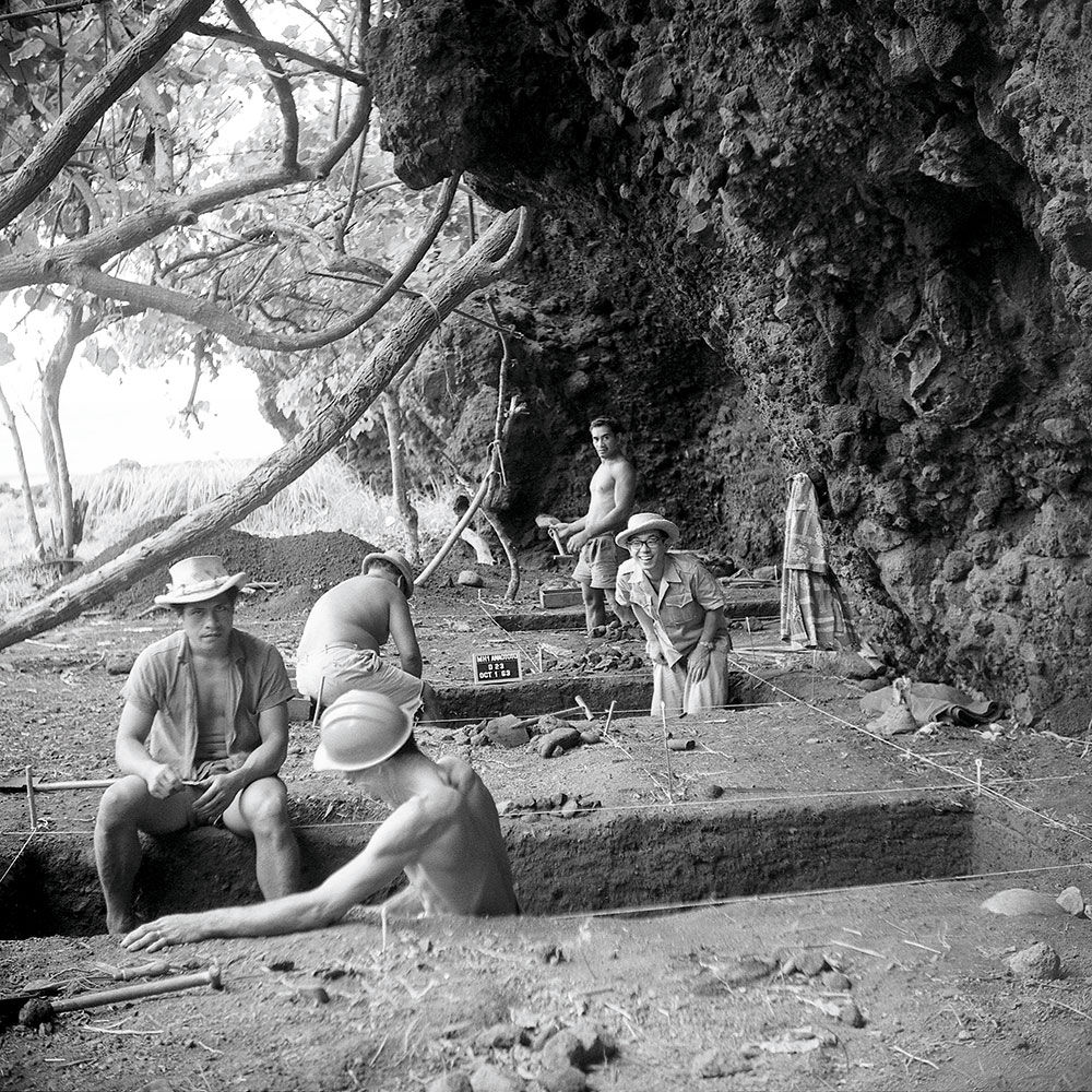 Black and white photo of men digging
