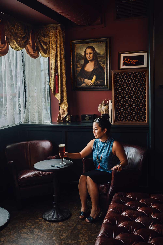 A guest of The HI Brau Room enjoying a pint of beer.