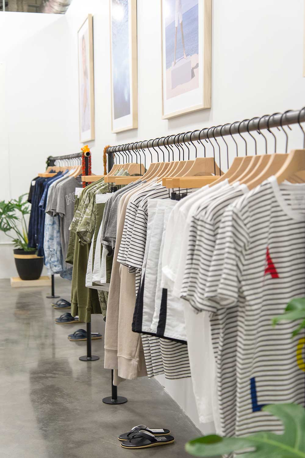 Rows of shirts hanging on racks
