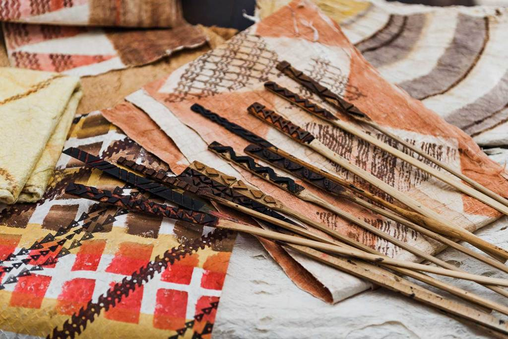 Kapa cloth and the various tools used for the designs.