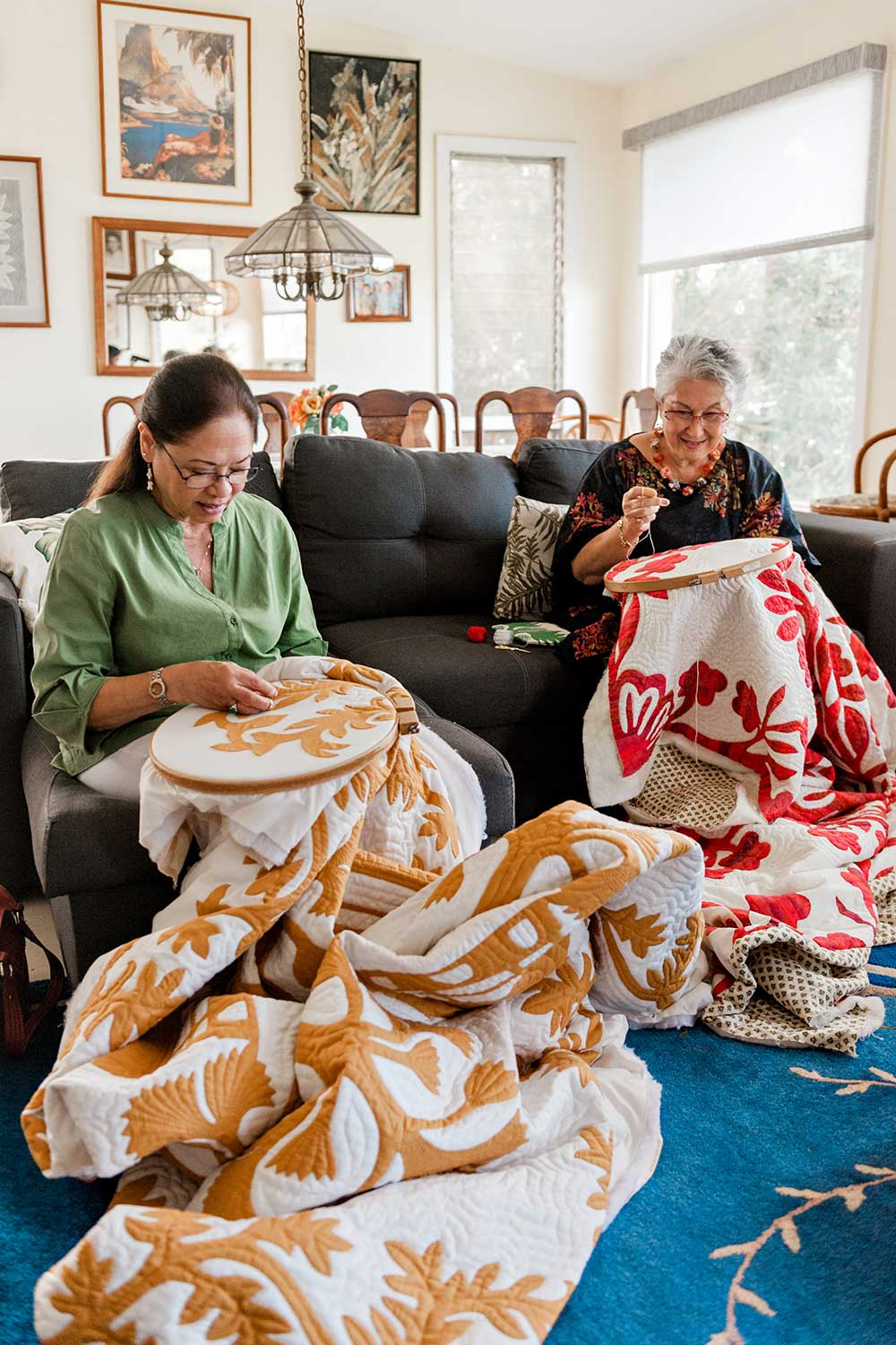 Pat Gorelangton and Patricia Lei Murray quilting together.
