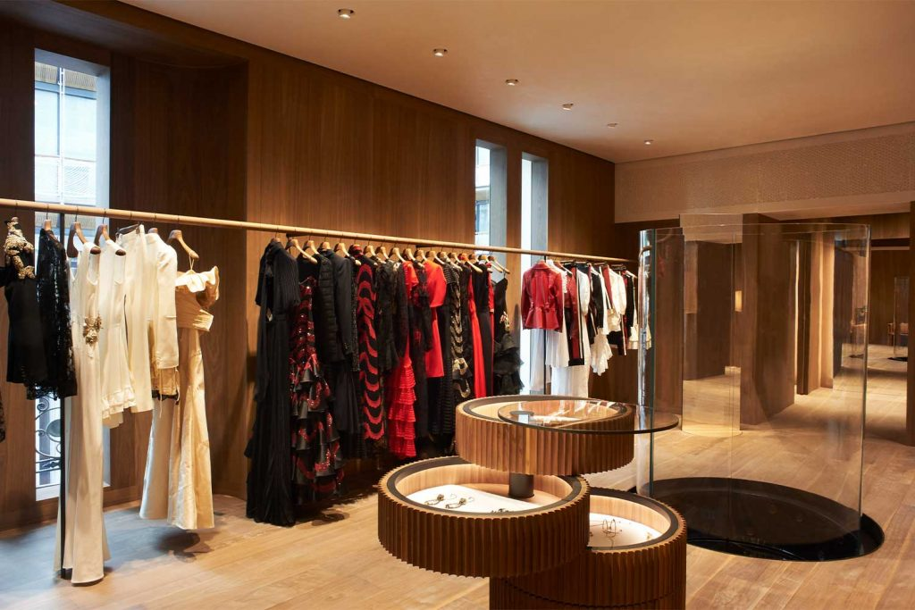 Elegant room displaying a rack of Alexander McQueen garments