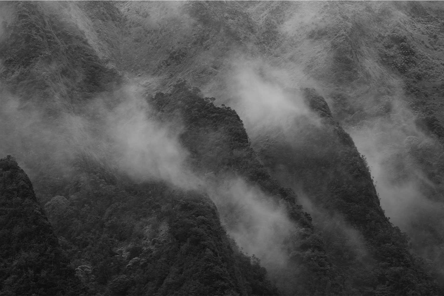 Black and white image of mist covering the ridges of the Koolau mountain range