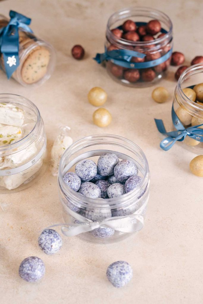 Close up shot of jars of small round candies
