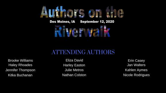This image has an empty alt attribute; its file name is authors-on-riverwalk-des-moines.jpg