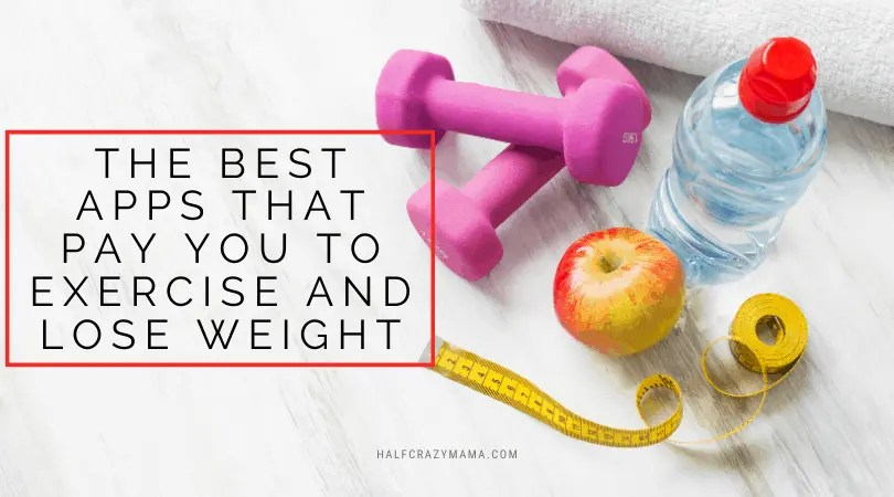 weights, apple and tape measure on a counter