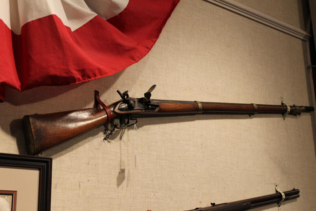 old fashioned rifle on a wall