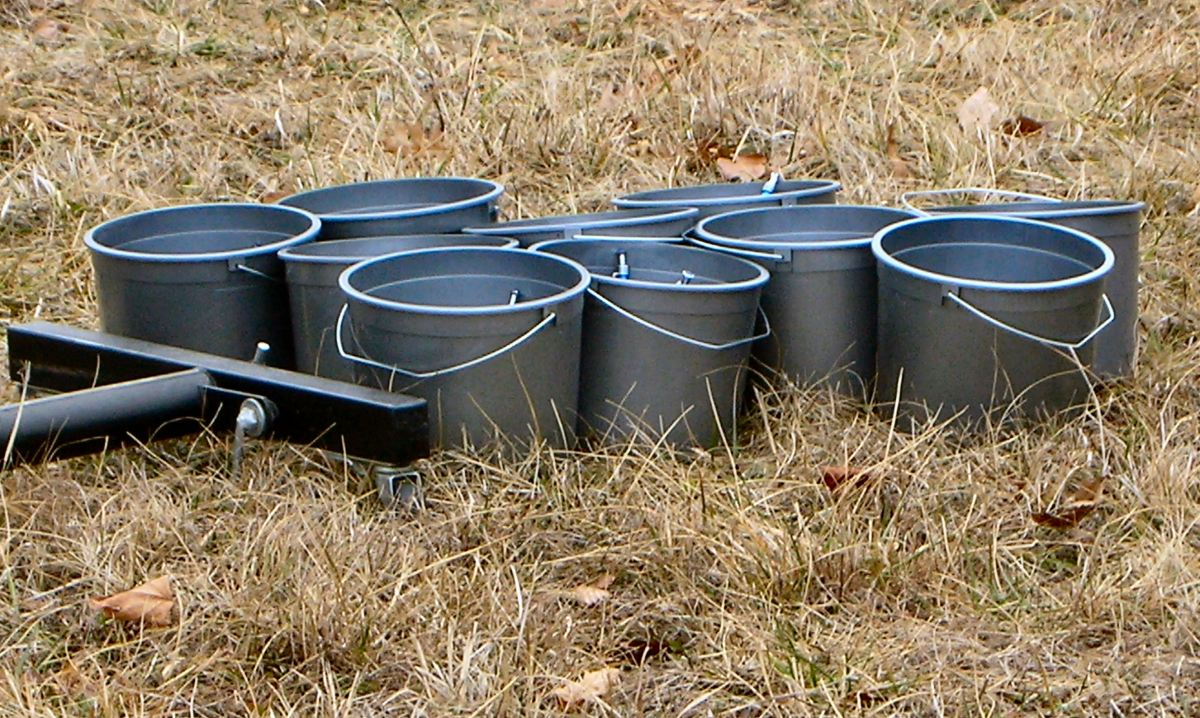 A Bunch of Buckets in a field