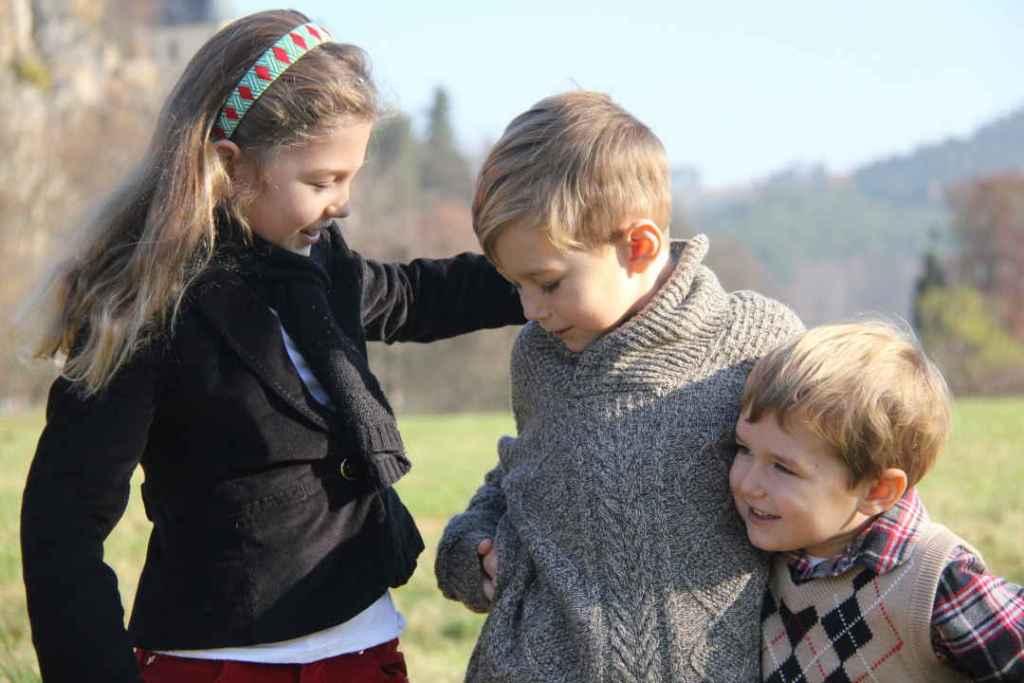 close up of Anna, Oliver & Sam smiling